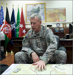 "Gen. McKiernan sits in his office at ISAF headquarters in Kabul. ""I don't like to use the word 'surge' here because if we put these additional forces in here, it's going to be for the next few years,"" he said. ""It's not a temporary increase of combat strength."""